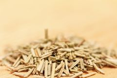 Heap of dried rosemary on a wooden background Stock Photography
