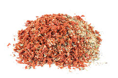 Heap of dried tomato with garlic and basil spice Royalty Free Stock Photos
