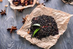 Heap of dry black tea leaves on paper royalty free stock images