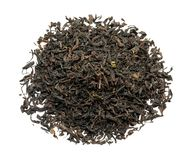 Heap of dry black tea leaves on white background royalty free stock photo
