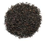 Heap of dry black tea leaves on white background, top view royalty free stock photography
