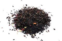 Heap of dry black tea on white background stock image