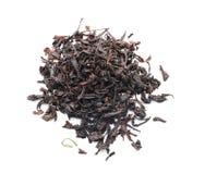 Heap of dry black tea on white background royalty free stock image
