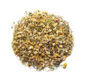 Heap of dry camomile tea on white background royalty free stock images
