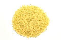 Heap of dry couscous isolated on white. Top view royalty free stock image
