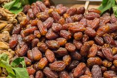 Heap of dry dates at a market place. Heap of fresh dry dates at a market place Royalty Free Stock Images