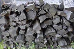 Heap of dry firewood. Dry firewood for firing and heating lie in a pile in the backyard royalty free stock photo