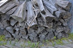 Heap of dry firewood. Dry firewood for firing and heating lie in a pile in the backyard royalty free stock photos