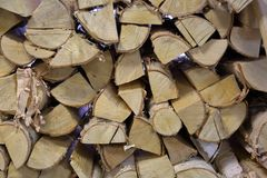 Heap of dry firewood. Dry firewood for firing and heating lie in a pile in the backyard royalty free stock images
