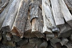 Heap of dry firewood. Dry firewood for firing and heating lie in a pile in the backyard stock image