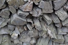 Heap of dry firewood. Dry firewood for firing and heating lie in a pile in the backyard stock images