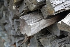 Heap of dry firewood. Dry firewood for firing and heating lie in a pile in the backyard stock photo