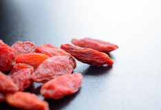 Heap of Dry Goji Berries on the Dark Table Stock Photography