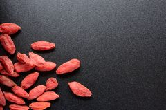 Heap of Dry Goji Berries on the Dark Table Royalty Free Stock Photo