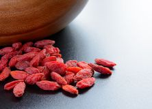 Heap of Dry Goji Berries on the Dark Table Royalty Free Stock Photos
