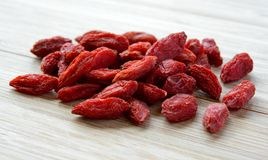 Heap of Dry Goji Berries on the Wooden Table Stock Image