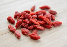 Heap of Dry Goji Berries on the Wooden Table Stock Photography