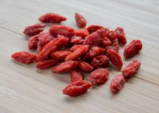 Heap of Dry Goji Berries on the Wooden Table Stock Images