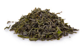 Heap of dry green tea isolated on white. Background Royalty Free Stock Image