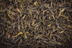 Heap of dry green tea (texture). Macro shot Stock Photos