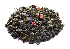 Heap of dry green tea on white background royalty free stock images