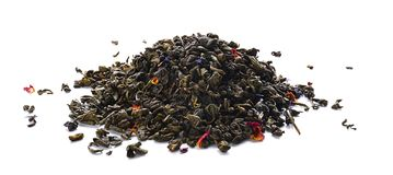 Heap of dry green tea on white background royalty free stock photography