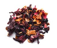 Heap of dry hibiscus tea with fruits on white background royalty free stock photo