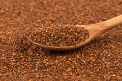 Heap of dry rooibos tea. Heap of red dry rooibos healthy traditional organic tea in spoon Royalty Free Stock Photography