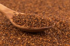 Heap of dry rooibos tea. Heap of red dry rooibos healthy traditional organic tea in spoon Stock Photos