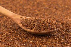 Heap of dry rooibos tea. Heap of red dry rooibos healthy traditional organic tea in spoon Royalty Free Stock Photo