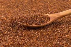 Heap of dry rooibos tea. Heap of red dry rooibos healthy traditional organic tea in spoon Royalty Free Stock Image