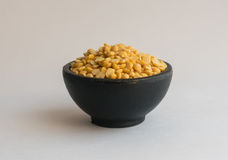 Heap of Dry Split Yellow Peas in Black Round Bowl Royalty Free Stock Images