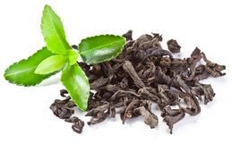 Heap of dry tea with green tea leaves. Heap of dry tea with green tea leaves isolated on a white background Stock Photos