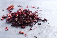 Heap of dry tea. On grey table Royalty Free Stock Photography