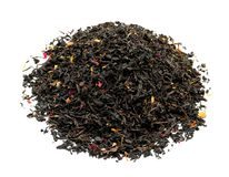Heap of dry tea leaves with flower petals on white background stock image