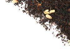 Heap of dry tea leaves. On white background Stock Photos