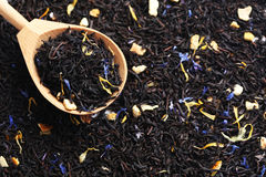 Heap of dry tea. In wooden spoon Royalty Free Stock Images