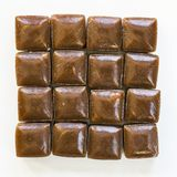 Heap Dutch coffee candy called `hopjes` against white background stock photography