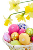 Heap of easter eggs and daffodils Royalty Free Stock Photos