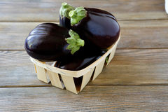 Heap of eggplant in a box stock photo