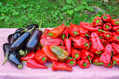 Heap of eggplants and red peppers Royalty Free Stock Photo