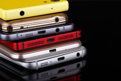 Heap of electronical devices - smartphones on black bac Royalty Free Stock Photos