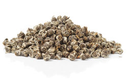 Heap of elite oolong tea. Heap of elite whole leaf oolong tea isolated on pure white with slight reflection Stock Photo