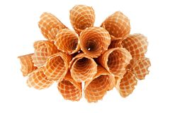 Heap of empty crispy ice-cream waffle cones on white background isolated closeup top view royalty free stock image