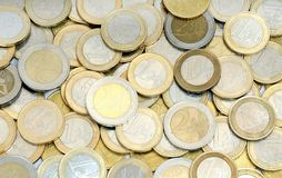Heap of euro coins money. Upper view on one and two euro coins money Stock Photos