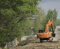 Heap Excavators digging the ground royalty free stock photos