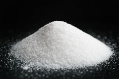Heap of extra small salt on black background stock images