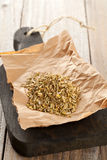 Heap of fennel seeds on kitchen board Stock Photo