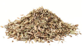 Heap of fennel seeds, macro shot, isolated Royalty Free Stock Images