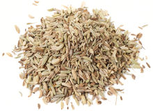 Heap of fennel seeds, macro shot, isolated Stock Images